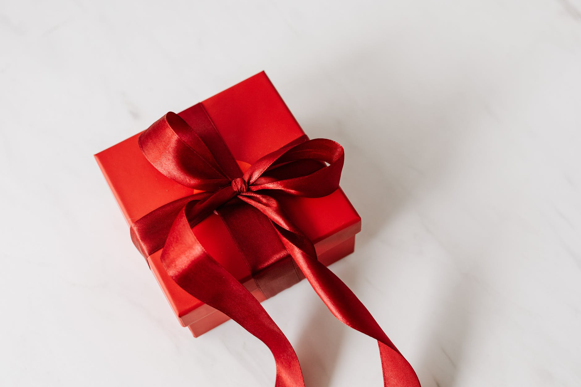 red gift box tied with ribbon