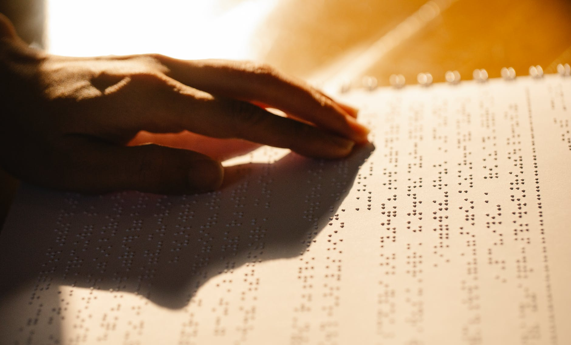 close up photo of person using book for the visually impaired