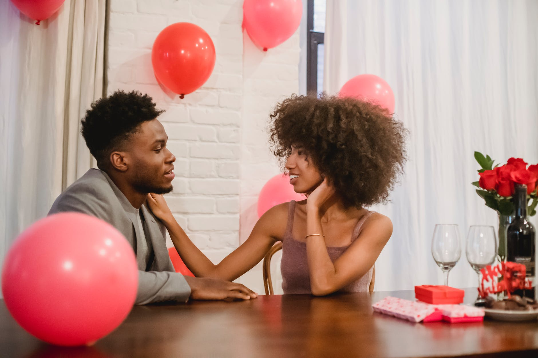 african american couple having date at table with presents
