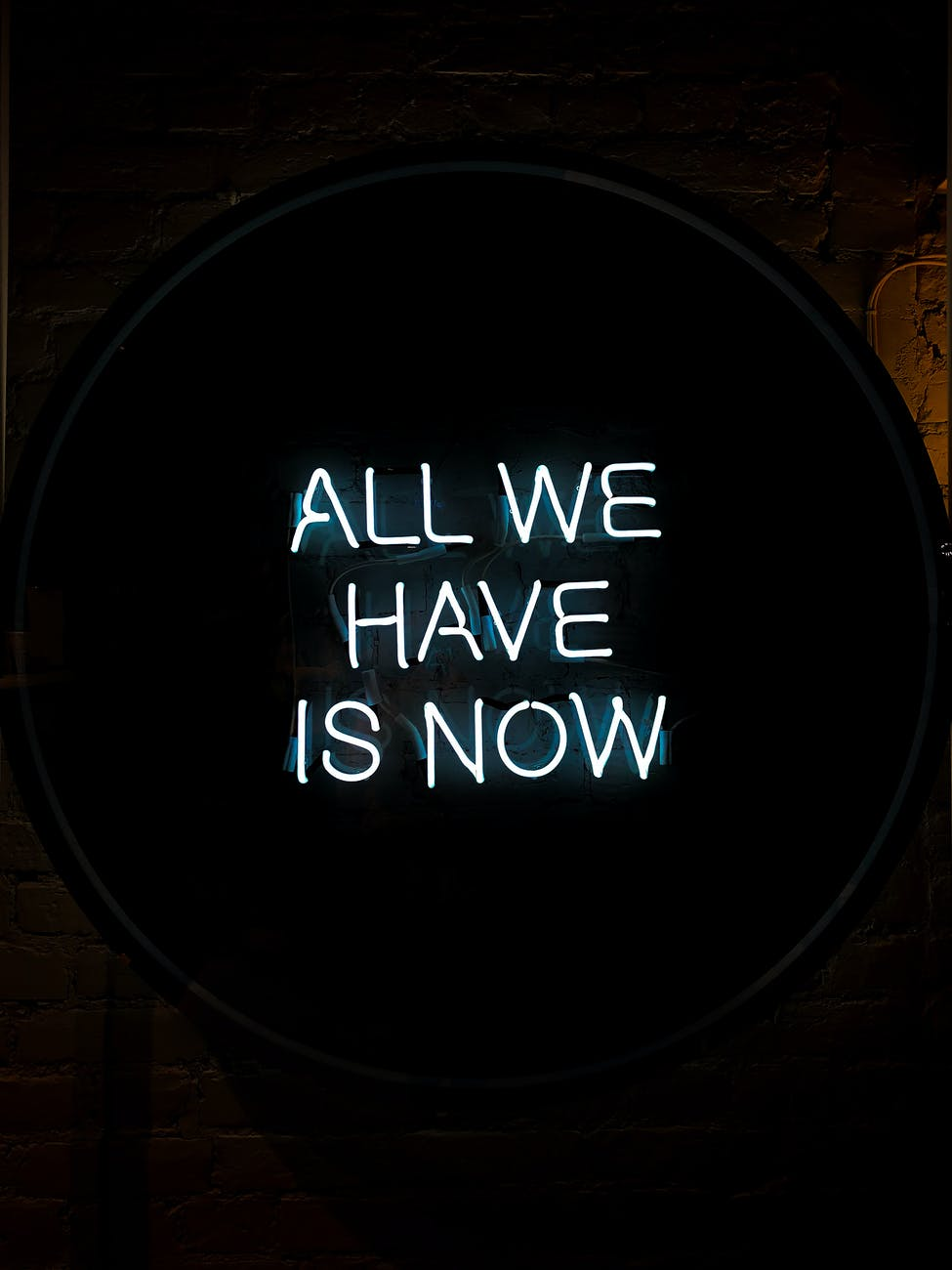 all we have is now neon signage on black surface